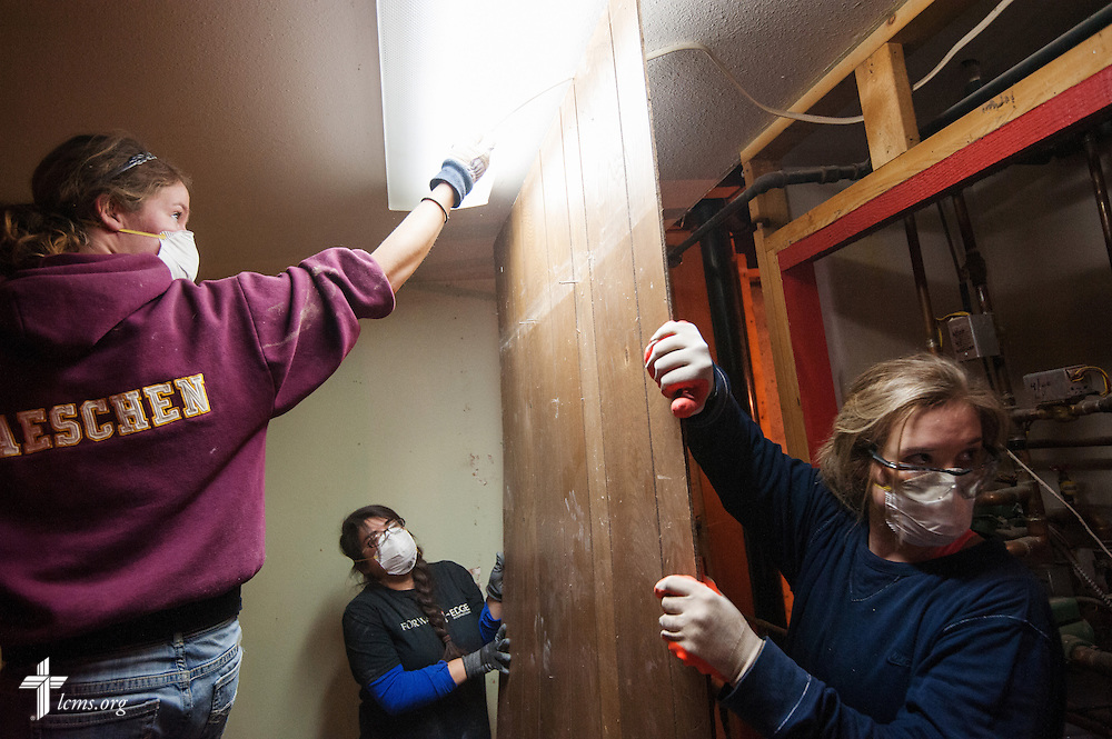 (L-R) Keri Maeschen, a student with Mt. Calvary Lutheran Student Fellowship at South Dakota State University is helped by George Fox University students Daisy Gallegos and Emily Thiessen as they help gut the interior of a home damaged by the September flooding on Wednesday, Jan. 8, 2014, in Pinewood Springs, Colo. LCMS Communications/Erik M. Lunsford