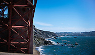 View of the San Francisco coastline, from Fort Point beneath the Golden Gate Bridge