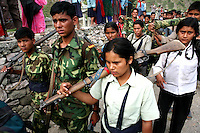 Members of the People?s Liberation Army, the Maoist rebels that have been fighting for control of the country, patrol in a remote part of western Nepal on June 22, 2006. The ten-year old conflict in Nepal has claimed an estimated 13,000 lives. (Photo/Scott Dalton)