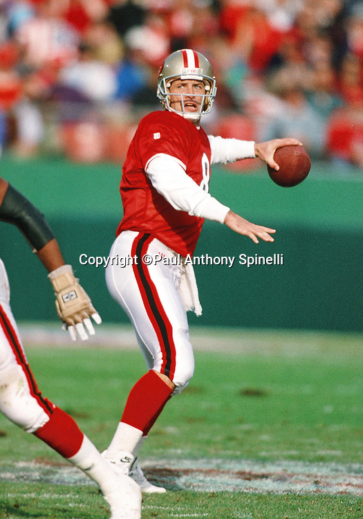 San Francisco 49ers quarterback Steve Young (7) throws a pass during the NFL football game against the Denver Broncos on Dec. 17, 1994 in San Francisco. The 49ers won the game 42-19. (©Paul Anthony Spinelli)