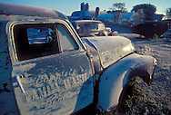 Abandoned panel delivery trucks covered with frost at dawn on a central Wisconsin farm.