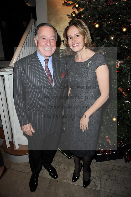 JOHN RITBLAT and CAROLINE MICHEL at the Linley Christmas Party and launch of the book 'Star Pieces' by David Linley, Charles Cator and Helen Chislett held at Linley, 60 Pimlico Road, London on 18th November 2009.