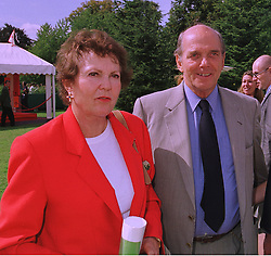 PRINCESS MARIA PIA OF SAVOY and her husband PRINCE MICHEL DE BOURBON-PARMA, at a reception in Paris on 6th September 1998. MJR 104 2olo