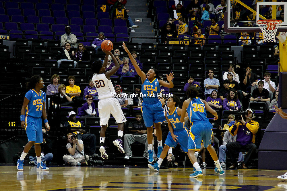 December 13, 2011; Baton Rouge, LA; LSU Lady Tigers guard Destini Hughes (20) shoots over UCLA Bruins forward Atonye Nyingifa (11) during the second half of a game at the Pete Maravich Assembly Center. LSU defeated UCLA 58-41. Mandatory Credit: Derick E. Hingle-US PRESSWIRE