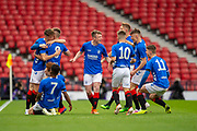 Ciaran Dickson (#8) of Rangers FC is mobbed by team mates after scoring a goal during the Scottish FA Youth Cup Final match between Celtic and Rangers at Hampden Park, Glasgow, United Kingdom on 25 April 2019.