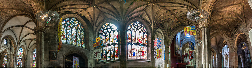 "Panorama inside St Giles' Cathedral (High Kirk of Edinburgh), the principal place of worship of the Church of Scotland in Edinburgh. The church has been one of Edinburgh's religious focal points for approximately 900 years. The present church dates from the late 1300s, though it was extensively restored in the 1800s. Today it is sometimes regarded as the ""Mother Church of Presbyterianism."" The cathedral is dedicated to Saint Giles, who is the patron saint of Edinburgh, as well as of cripples and lepers, and was a very popular saint in the Middle Ages. Edinburgh is the capital city of Scotland, in Lothian on the Firth of Forth, Scotland, United Kingdom, Europe. This image was stitched from several overlapping photos."