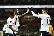 Moussa Sissoko of Tottenham Hotspur is congratulated by teammate, Erik Lamela after his shot was deflected into the goal by Dan Butler of Newport County during the The FA Cup fourth round replay match between Tottenham Hotspur and Newport County at Wembley Stadium, London, England on 6 February 2018. Picture by Toyin Oshodi.