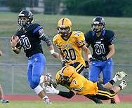 Central Bucks South's Justin Schreiber #20 runs with the football as Central Bucks West's Tj Rakowsky dives after him in the first quarter at Central Bucks South Friday September 4, 2015 in Warrington, Pennsylvania.  (Photo by William Thomas Cain)
