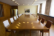 The conference room where the heads of the GDR secret police met with district administrators, an exhibit in 'Haus 1' the ministerial headquarters of the Stasi secret police in Communist East Germany, the GDR. Built in 1960, the complex now known as the Stasi Museum. Before the fall of the Wall, it was a 22-hectare complex of espionage whose centrepiece is the office and working quarters of the former Minister of State Security, Erich Mielke who considered their role as the 'shield and sword of the party', conducting one of the world's most efficient spying operations against its political dissenters during its 40-year old socialist history. Between 1950 and 1989, the Stasi employed a total of 274,000 people in an effort to root out the class enemy. During Hitler's Third Reich, the Gestapo had one agent for every 2,000 citizens whereas the Stasi had approximately an spy for every 6.5. Here at the Stasi HQ alone 15,000 were employed plus the many regional stations. German media called East Germany 'the most perfected surveillance state of all time' - administered from this complex of offices.
