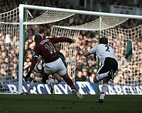 Photo: Lee Earle.<br /> Fulham v Arsenal. The Barclays Premiership. 04/03/2006. Arsenal's Thierry Henry (L) scores the opening goal.