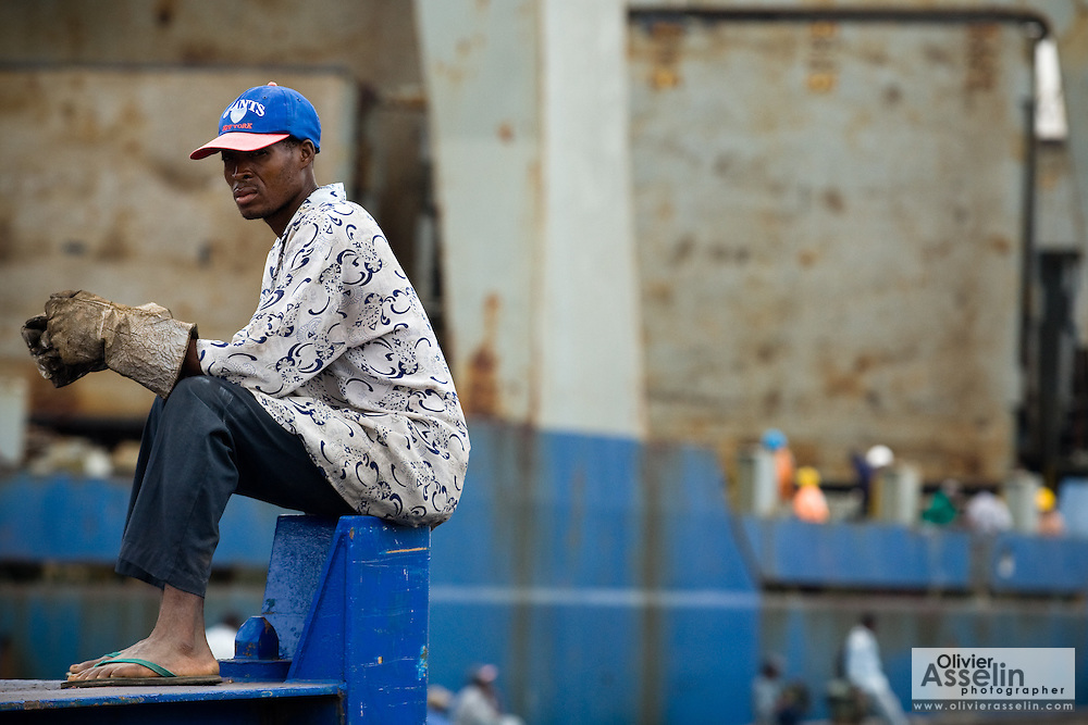 Worker sitting at the sea port in Lome, Togo on Friday October 3, 2008.