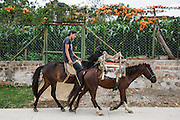 A young man rides a horse in the town of Valle de Angeles, Honduras on Friday April 26, 2013.