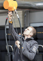 October 21, 2018 - Austin, USA - A member of the McLaren racing team connects equipment in the pit area before the start of the Formula 1 U.S. Grand Prix at the Circuit of the Americas in Austin, Texas on Sunday, Oct. 21, 2018. (Credit Image: © Scott Coleman/ZUMA Wire)