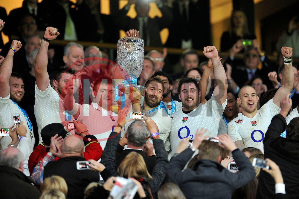 England captain Chris Robshaw lifts the Cook Cup after England triumph over Australia - Photo mandatory by-line: Patrick Khachfe/JMP - Mobile: 07966 386802 29/11/2014 - SPORT - RUGBY UNION - London - Twickenham Stadium - England v Australia - QBE Internationals