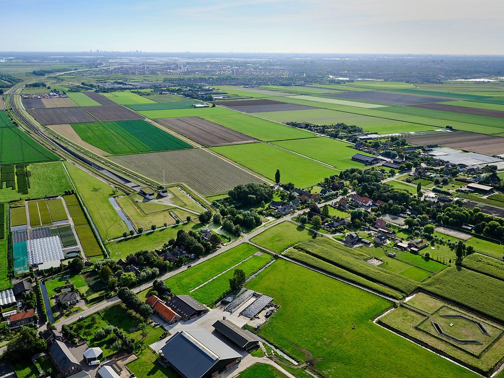 Nederland, Zuid-Holland, Hazerswoude-Dorp, 14-09-2019; Westeinde, Polder de Noordplas, zuidelijke ingang boortunnel HSL-spoorlijn. De tunnel is ook bekend als tunnel onder het Groene Hart. HSL gaat richting Rotterdam, skyline aan de horizon.<br /> Entrance highspeed train tunnel<br /> <br /> luchtfoto (toeslag op standard tarieven);<br /> aerial photo (additional fee required);<br /> copyright foto/photo Siebe Swart