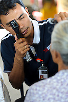 Staff of Bali Eye assessing a patient for problems with her sight, Bali, Indonesia.