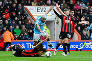 Nathan Ake (5) of AFC Bournemouth goes down under a challenge from Sergio Aguero (10) of Manchester City during the Premier League match between Bournemouth and Manchester City at the Vitality Stadium, Bournemouth, England on 2 March 2019.