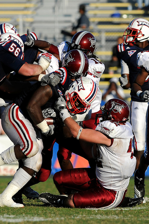December 4, 2010: Brannon Bryan of the Troy Trojans tackles Xavier Stinson of the Florida Atlantic Owls during the NCAA football game between Troy and FAU. The Trojans defeated the Owls 44-7.