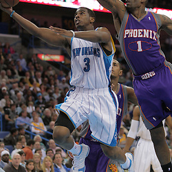03 December 2008:  New Orleans Hornets guard Chris Paul (3) shoots past Phoenix Suns forward Amare Stoudemire (1) during a 104-91 victory by the New Orleans Hornets over the Phoenix Suns at the New Orleans Arena in New Orleans, LA..