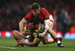 South Africa's Dillyn Leyds is tackled by Wales' Steff Evans during the Autumn International at the Principality Stadium, Cardiff.