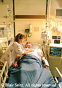Medical doctor, physician at work Patient, Hospital Intensive Care Unit Physician and Patient in Intensive Care Unit