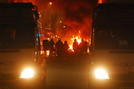 Police and other emergency services deal with a public disorder  and fires started by rioters.