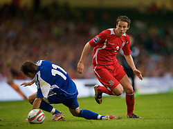 CARDIFF, WALES - Saturday, October 11, 2008: Wales' Chris Gunter and Liechtenstein's Franz Burgmeier during the 2010 FIFA World Cup South Africa Qualifying Group 4 match at the Millennium Stadium. (Photo by David Rawcliffe/Propaganda)