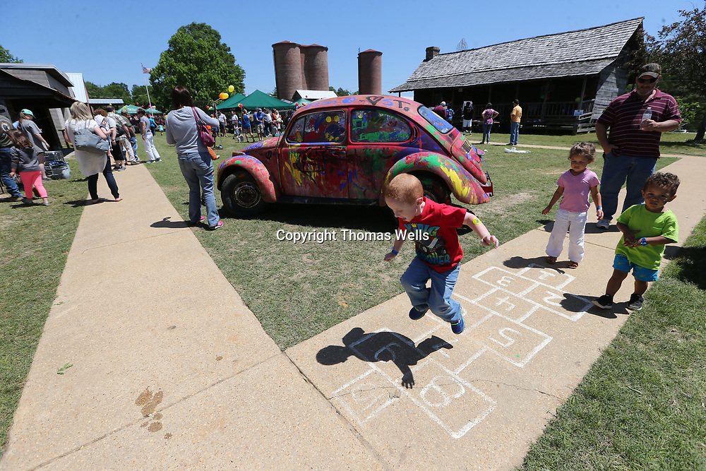 Brady Lindsey, 4, of Shannon gets to play a game of hopscocth at Saturday's Dudie Burge Festival at the Oren Dunn Muesum in Tupelo.