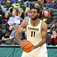 4th year forward Brian Ofori (11) of the Regina Cougars in action during the home game on December  2 at Centre for Kinesiology, Health and Sport. Credit: Arthur Ward/Arthur Images
