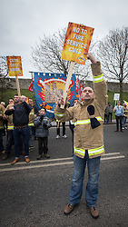© Licensed to London News Pictures . 08/03/2014 . York , UK . Fire Brigades Union protest at the march . A TUC protest march against the Liberal Democrat and Conservative coalition government passes by the Barbican Centre in York . The second day of the Liberal Democrat Spring Conference today (Saturday 8th March 2014) . Photo credit : Joel Goodman/LNP