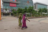 Two women working in Select City Walk shopping mall in Saket, New Delhi.