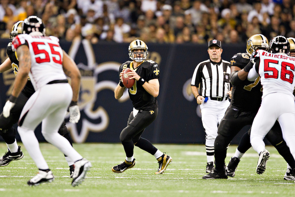 NEW ORLEANS, LA - DECEMBER 26:   Drew Brees #9 of the New Orleans Saints drops back to pass against the Atlanta Falcons at Mercedes-Benz Superdome on December 26, 2011 in New Orleans, Louisiana.  The Saints defeated the Falcons 45-16.  (Photo by Wesley Hitt/Getty Images) *** Local Caption *** Drew Brees