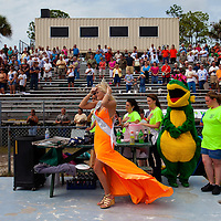 NAPLES, FL -- March 6, 2011 -- Swamp Buggy Queen Christa Jo Roberts listens the National Anthem during the Swamp Buggy Races at the Florida Sports Park in Naples, Fla., on Sunday, March 6, 2011.  The races originated in the 1940's by bored hunters and draws thousands of fans three times a year to take in the buggies and jeep compete in the swamp. (Chip Litherland for ESPN the Magazine)