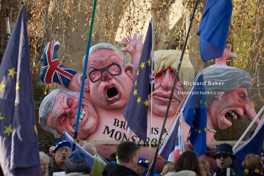 As Prime Minister Theresa May tours European capitals hoping to persuade foreign leaders to accept a new Brexit deal (following her cancellation of a Parliamentary vote), pro-EU Remainers protest beneath the statue of King George V beneath Westminster Abbey and opposite the Houses of Parliament, on 11th December 2018, in London, England. The figures depict (L-R) David Davies, Michael Gove, Boris Johnson and Theresa May.