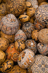 South America, Ecuador, Saquisili, carved gourds on display at weekly food and crafts market which draws indigenous people and tourists from surrounding villages