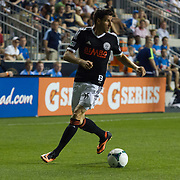 Philadelphia Union Forward SEBASTIEN LE TOUX (11) dribbles the ball in front of him in the second half a MLS regular season international friendly match against Stoke City F.C. Tuesday, July. 30, 2013 at PPL Park in Chester PA.