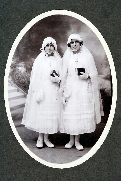 two girls posing on there holy communion day