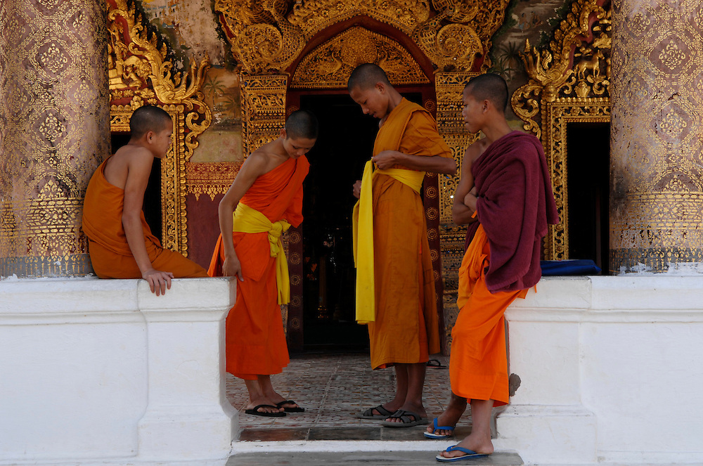 Luang Prabang. Novice Buddhist monks come to lodge in the town's temples whilst learning the life of a monk, such as here at Wat Paphai