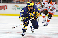 November 21, 2009:  Michigan's A.J. Treais (21) during the NCCA hockey game between Michigan and the Bowling Green State University at Lucas County Arena in Toledo, Ohio.
