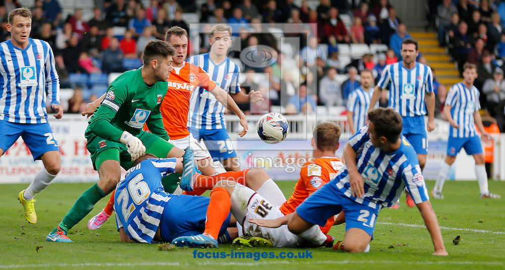 A scramble for the ball in Hartlepool United's box during the Sky Bet League 2 match at Victoria Park, Hartlepool<br /> Picture by Simon Moore/Focus Images Ltd 07807 671782<br /> 18/10/2014