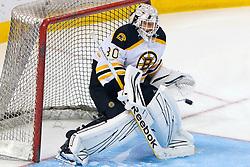 Mar 22, 2012; San Jose, CA, USA; Boston Bruins goalie Tim Thomas (30) warms up before the game against the San Jose Sharks at HP Pavilion. Mandatory Credit: Jason O. Watson-US PRESSWIRE