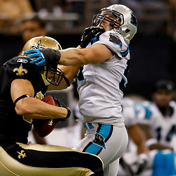 January 1, 2012; New Orleans, LA, USA; New Orleans Saints tight end Jimmy Graham (80) catches a pass over Carolina Panthers linebacker Jordan Senn (57) during the third quarter of a game at the Mercedes-Benz Superdome. Mandatory Credit: Derick E. Hingle-US PRESSWIRE