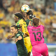 GRENOBLE, FRANCE June 18.  Sam Kerr #20 of Australia and Chloe Logarzo #6 of Australia challenge for the ball with Khadija Shaw #11 of Jamaica and Nicole McClure #13 of Jamaica during the Jamaica V Australia, Group C match at the FIFA Women's World Cup at Stade des Alpes on June 18th 2019 in Grenoble, France. (Photo by Tim Clayton/Corbis via Getty Images)