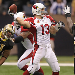 16 January 2010: Arizona Cardinals quarterback Kurt Warner (13) throws as New Orleans Saints defenders defensive tackle Sedrick Ellis (98) and defensive end Will Smith (91) provide pressure during the first half of the 2010 NFC Divisional Playoff game at the Louisiana Superdome in New Orleans, Louisiana.