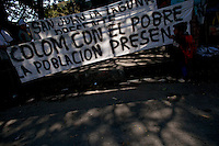 A young boy looks at a banner in support of the President as citizens take to the streets as a day of protest in connection with Guatemala's President Alvaro Colom fill the Central Plaza in Guatemala City May 17, 2009. . Thousands of protesters took to the streets of the capital  Sunday in two separated rival marches, one in support of the President and one denouncing President Alvaro Colom who was accused this week of murder, money laundering and having ties with narco-traffickers.(Darren Hauck)