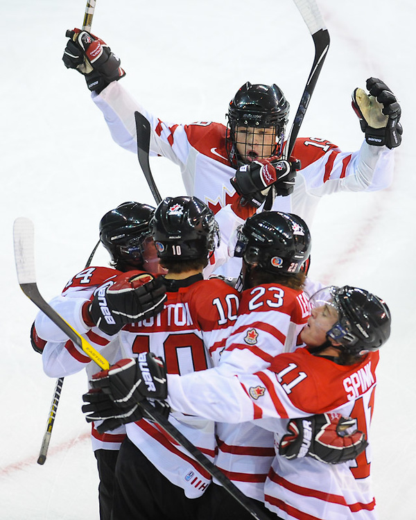 LANGLEY, CANADA - NOVEMBER 09: Team Canada celebrates the goal of Ben Hutton #10 of Canada East of Russia at Langley Events Center on November 9, 2011 in Langley, British Columbia, Canada. (Photo by Derek Leung/Getty Images)