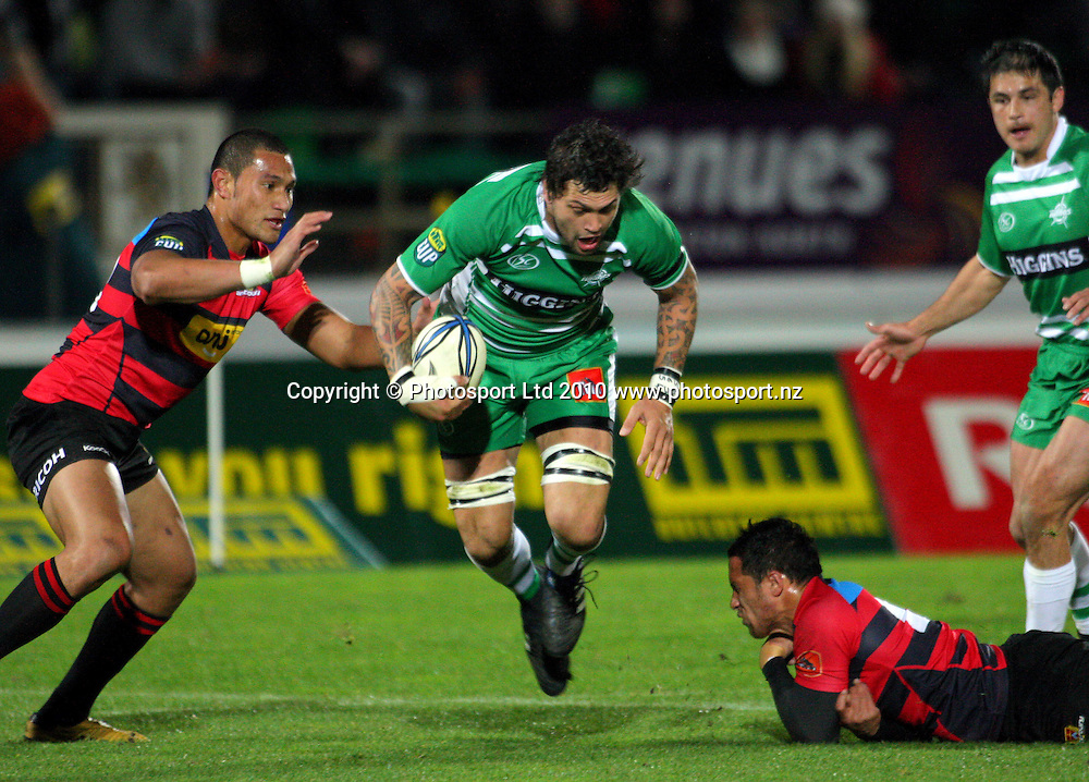 Manawatu lock Reece Robinson tries to beat the tackles of Robbie Fruean (left) and Stephen Brett. ITM Cup rugby - Manawatu Turbos v Canterbury at FMG Stadium, Palmerston North, New Zealand on Friday, 5 August 2010. Photo: Dave Lintott/Photosport