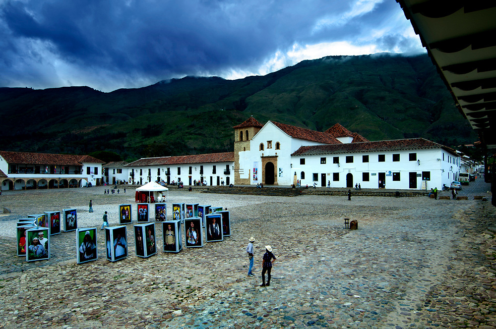 Colombia, Villa de Leyva, Boyaca Province, Colonial Town, National Monument, Plaza Mayor, Largest Plaza In The Country, Iglesia Parroquial, Andes Mountains, Photography Display Of Indigenous People Of Colombia
