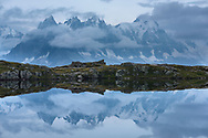 Reflexions of Les Aiguilles de Chamonix in the Lacs des Cheserys at dusk with clouds and moonshine, Chamonix, France / Impressionen bei den Lacs des Cheserys oberhalb von Chamonix, Mont-Blanc, an einem Spätsommertag im September