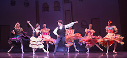 © Licensed to London News Pictures. 18/09/2015. London, UK. At the centre: Yakaterina Verbosovich (Chase Johnsey) as Kitri, Vyacheslav Legupski (Paolo Cervellera) as BasilLes Ballets Trockadero de Monte Carlo (The Trocks) perform the UK premiere of Don Quixote during a photocall at the Peacock Theatre. With Yakaterina Verbosovich (Chase Johnsey) as Kitri, Vyacheslav Legupski (Paolo Cervellera) as Basil, Olga Supphozova (Robert Carter) as Amour, Lariska Dumbcheno (Raffaele Morra) as Mother, Boris Nowitsky (Carlos Renedo) as Count and Varvara Bractchikova (Giovanni Goffredo) and Eugenia Repelskii (Joshua Thake) as Gypsies. Photo credit: Bettina Strenske/LNP